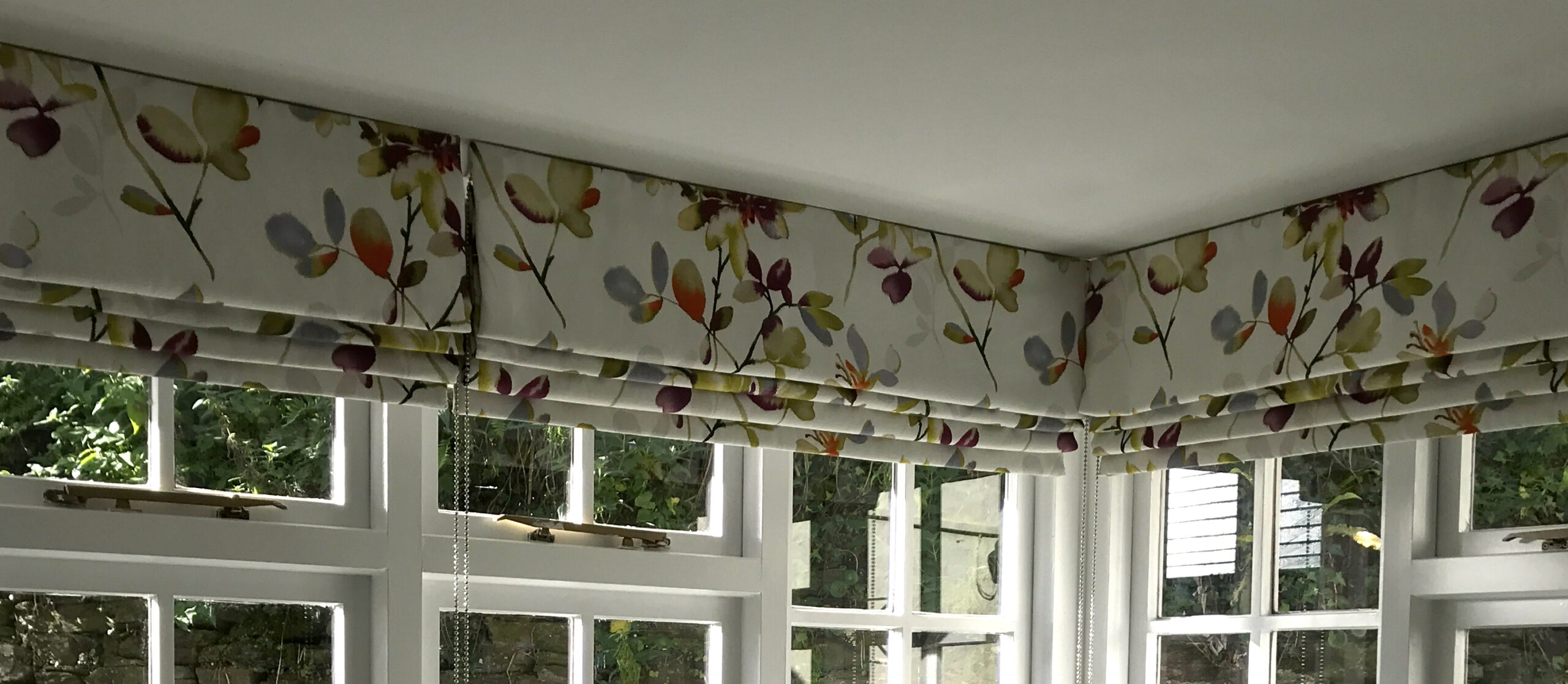 Roman Blinds in bay window.