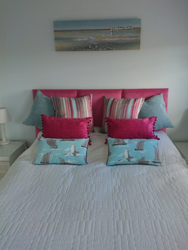 headboard and scatter cushions