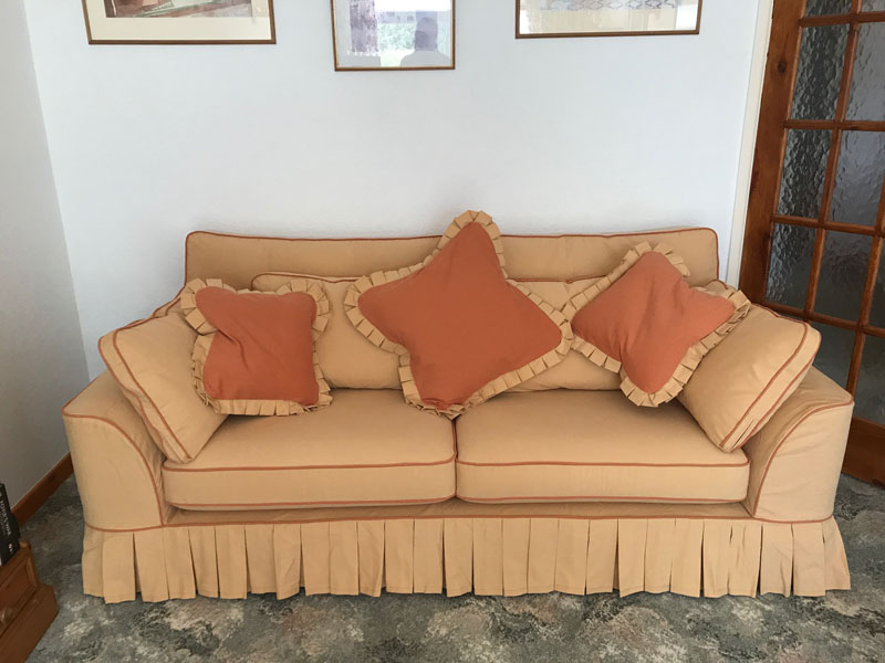 Loose covers for sofas with pleats